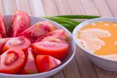 Fried egg with tomato recipe Stock Photos