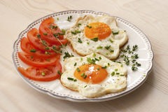 Fried egg with tomatoes Royalty Free Stock Photography