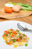 Fried egg topping fried vegetables with minced pork Royalty Free Stock Image