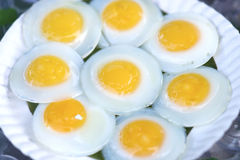 Fried egg in  tray white. On blue background Stock Photo
