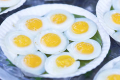 Fried egg in  tray white. On blue background Stock Images