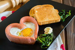 Fried egg Valentine`s day Stock Image