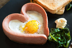 Fried egg Valentine`s day Stock Photos