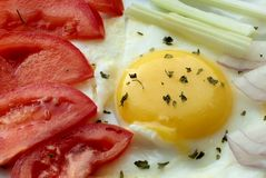 Fried egg and vegetables stock photos