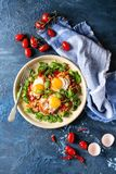 Fried egg with vegetables Royalty Free Stock Photography
