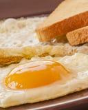 Fried egg on white toast Stock Image