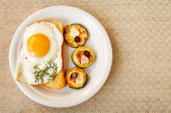 Fried egg and zucchini, breakfast Royalty Free Stock Photo