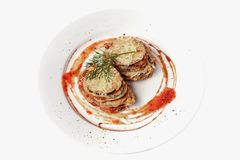 Fried eggplant cutlets with tomato sauce. Healthy veggie recipe. Top view. Isolated on white royalty free stock image