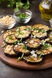 Fried eggplant with feta, pine nuts, fresh herbs (cilantro, parsley) and olive oil. Tasty vegetable snack, summer, spring food,. Picnic royalty free stock photography