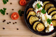 Fried eggplant slices with cottage cheese cream, spices. Royalty Free Stock Photo