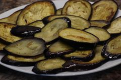 Fried eggplant with sunflower oil. thinly sliced and toasted, with a Golden crust.laid out on a plate for stuffing. fast and royalty free stock photography