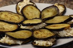 Fried eggplant with sunflower oil. thinly sliced and toasted, with a Golden crust.laid out on a plate for stuffing. fast and royalty free stock image