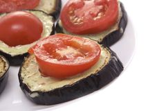 Fried eggplant with tomatoes and garlick sauce Stock Images