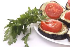 Fried eggplant with tomatoes and garlick sauce Royalty Free Stock Photography