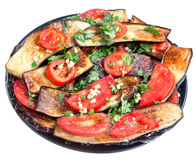 Fried eggplants with red tomato and garlic Royalty Free Stock Photo