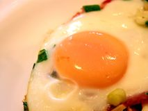 Fried eggs. A close shot of a fried egg royalty free stock image