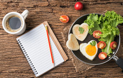 Fried Eggs And Bread In The Shape Of A Heart And Fresh Vegetable Royalty Free Stock Photos
