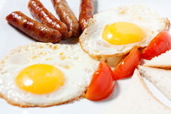 Fried Eggs And Fried Sausage Stock Photo