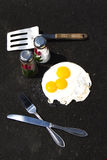 Fried Eggs on Asphalt Stock Images