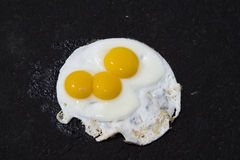 Fried Eggs On Asphalt Driveway. Humor Concept of eggs frying on sizzling hot asphalt driveway on hot summer day Stock Photo