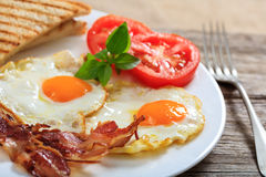Fried Eggs And Bacon images stock