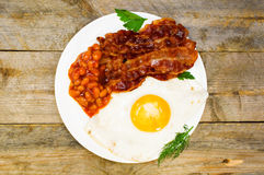 Fried eggs with bacon and beans Royalty Free Stock Photo