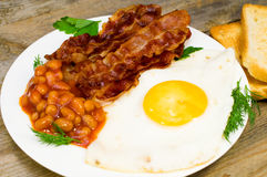 Fried eggs with bacon and beans Royalty Free Stock Photos