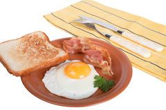 Fried eggs with bacon and bread isolated on white background Royalty Free Stock Images