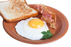 Fried eggs with bacon and bread isolated on white background Stock Image