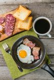 Fried eggs, bacon and coffee Stock Images
