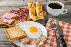 Fried eggs, bacon and coffee Royalty Free Stock Photography
