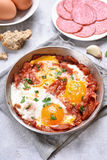 Fried eggs with bacon Stock Photos