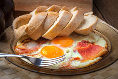 Fried eggs with bacon. Stock Images