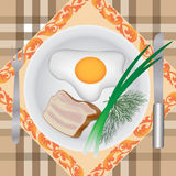 Fried eggs with bacon Stock Images
