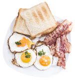 Fried Eggs and Bacon isolated on white Stock Photography