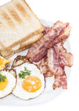 Fried Eggs and Bacon isolated on white Stock Images