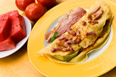 Fried eggs with bacon,melon and tomato Stock Images