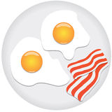 Fried eggs and bacon on plate Royalty Free Stock Photography