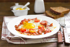 Fried eggs with bacon Royalty Free Stock Images