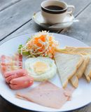 Fried eggs, bacon, sausage, toast and coffee Royalty Free Stock Photo