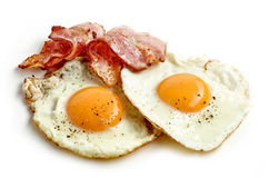 Fried eggs and bacon. Slices isolated on white background stock photos