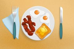 Fried eggs, bacon and toast Stock Photos
