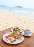 Fried eggs with bacon, toasts, green mango salad and coffee Stock Photography