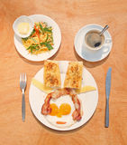 Fried eggs with bacon, toasts, green mango salad and coffee Stock Images