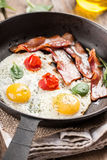 Fried eggs with bacon Royalty Free Stock Photography