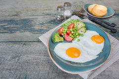 Fried eggs,  bacon, tomato and toasts Royalty Free Stock Photo