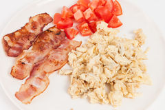 Fried eggs, bacon and tomatoes Royalty Free Stock Photos