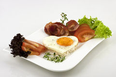 Fried eggs with bacon and tomatoes Royalty Free Stock Images