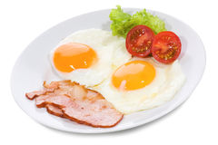 Fried eggs with  bacon and vegetables Royalty Free Stock Photo