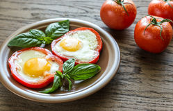 Fried eggs in bell pepper slices Royalty Free Stock Images